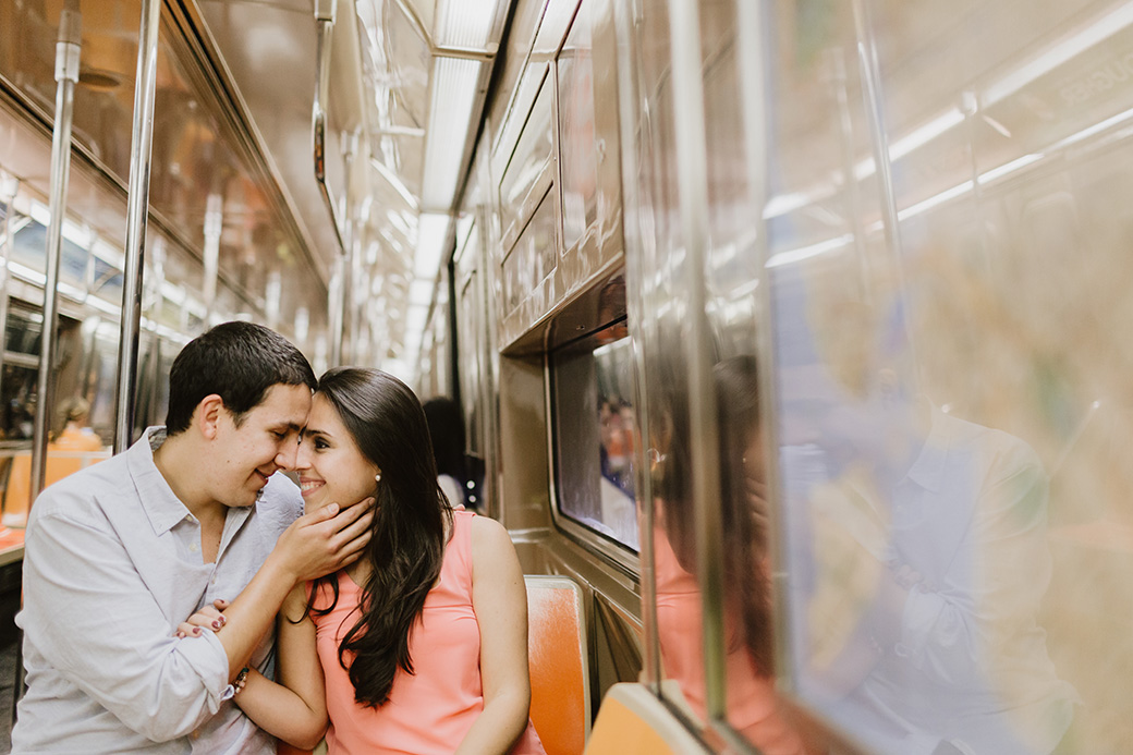 couple kissing on nyc subway