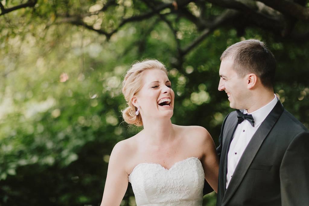 NYC wedding couple laughing