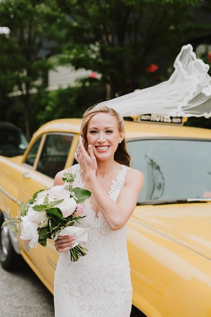 bride next to vintage taxi