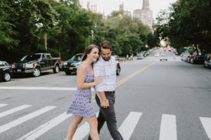Manhattan engaged couple crossing the street