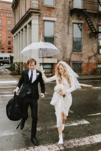 DUMBO Rainy day wedding couple