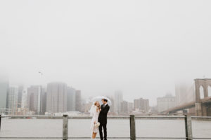 Rainy day wedding couple NYC