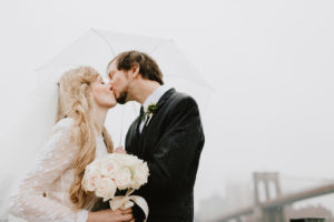 NYC rainy day bride and groom