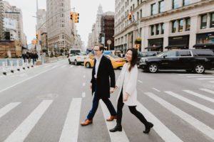 Flatiron engaged couple walking