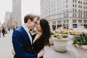 Flatiron engaged couple kissing
