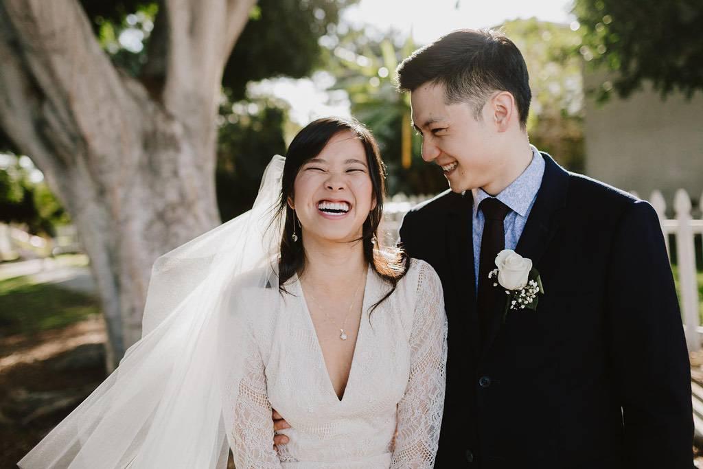 LA wedding couple laughing