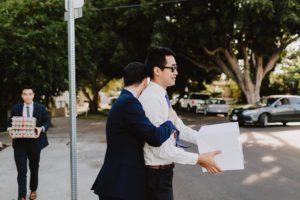 SmogShoppe LA groom hugging guest